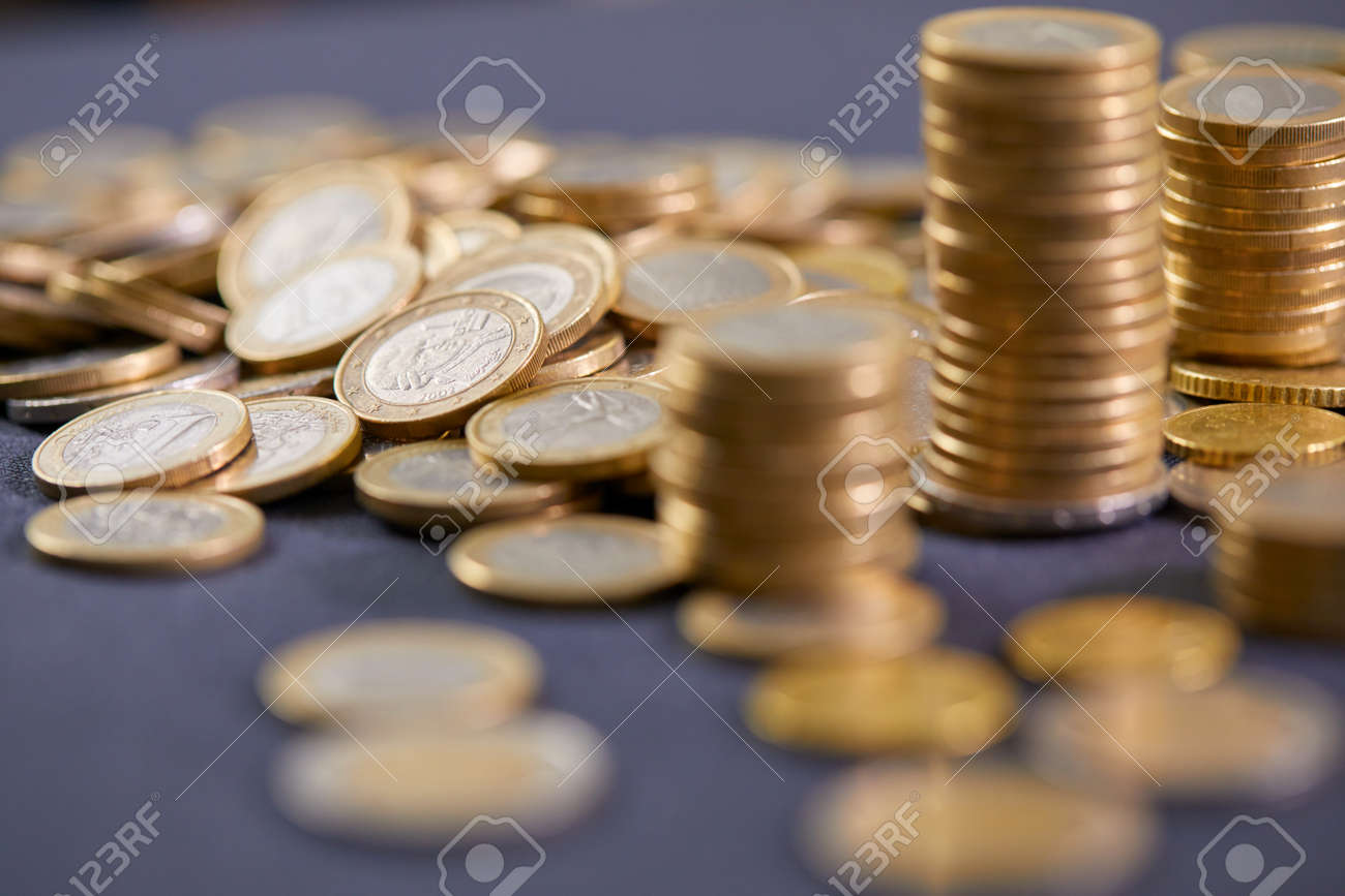 Stock Photo - Euro coins. Euro money. Euro currency.Coins stacked on each other in different positions. Money concept - 149069721