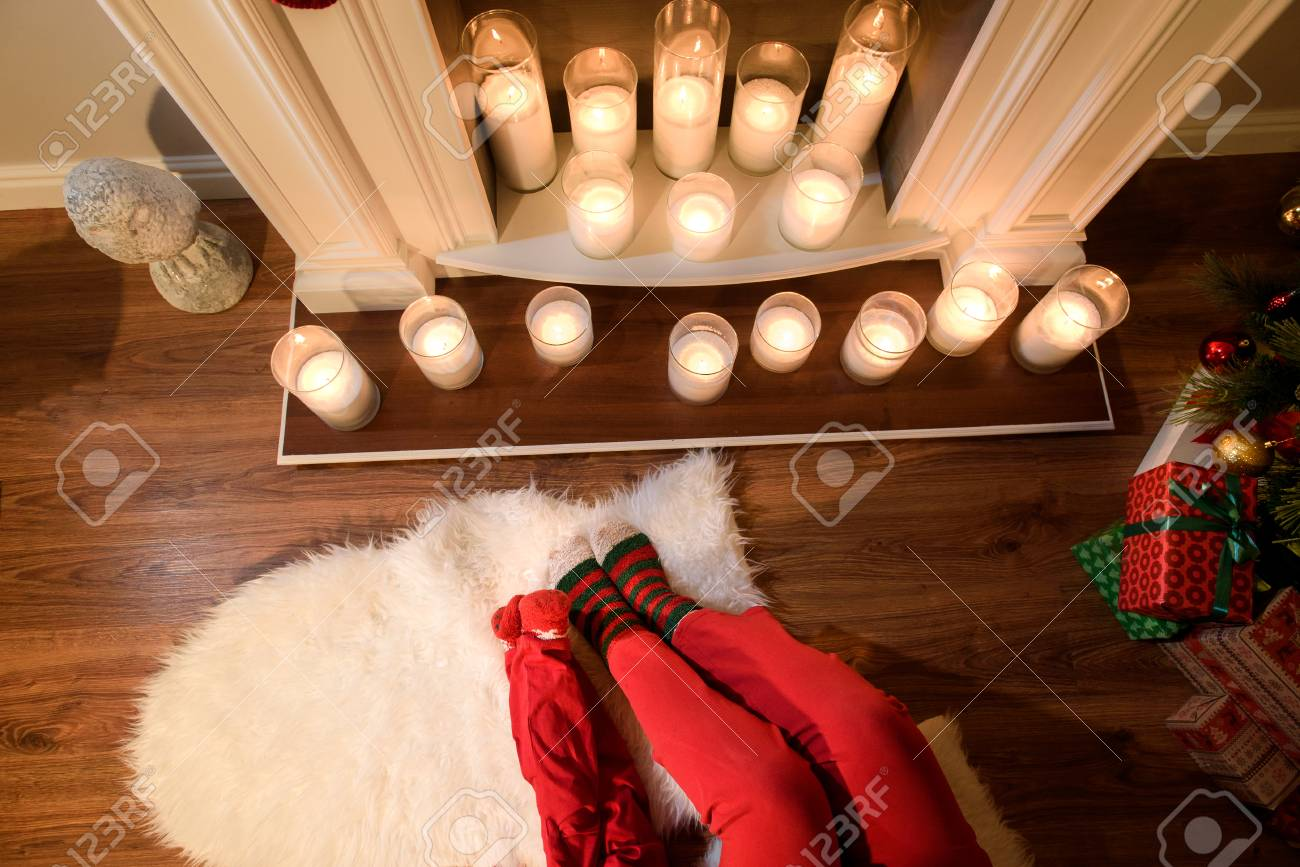 An Upper View On A Nice Fireplace With Elegant Candles And Two