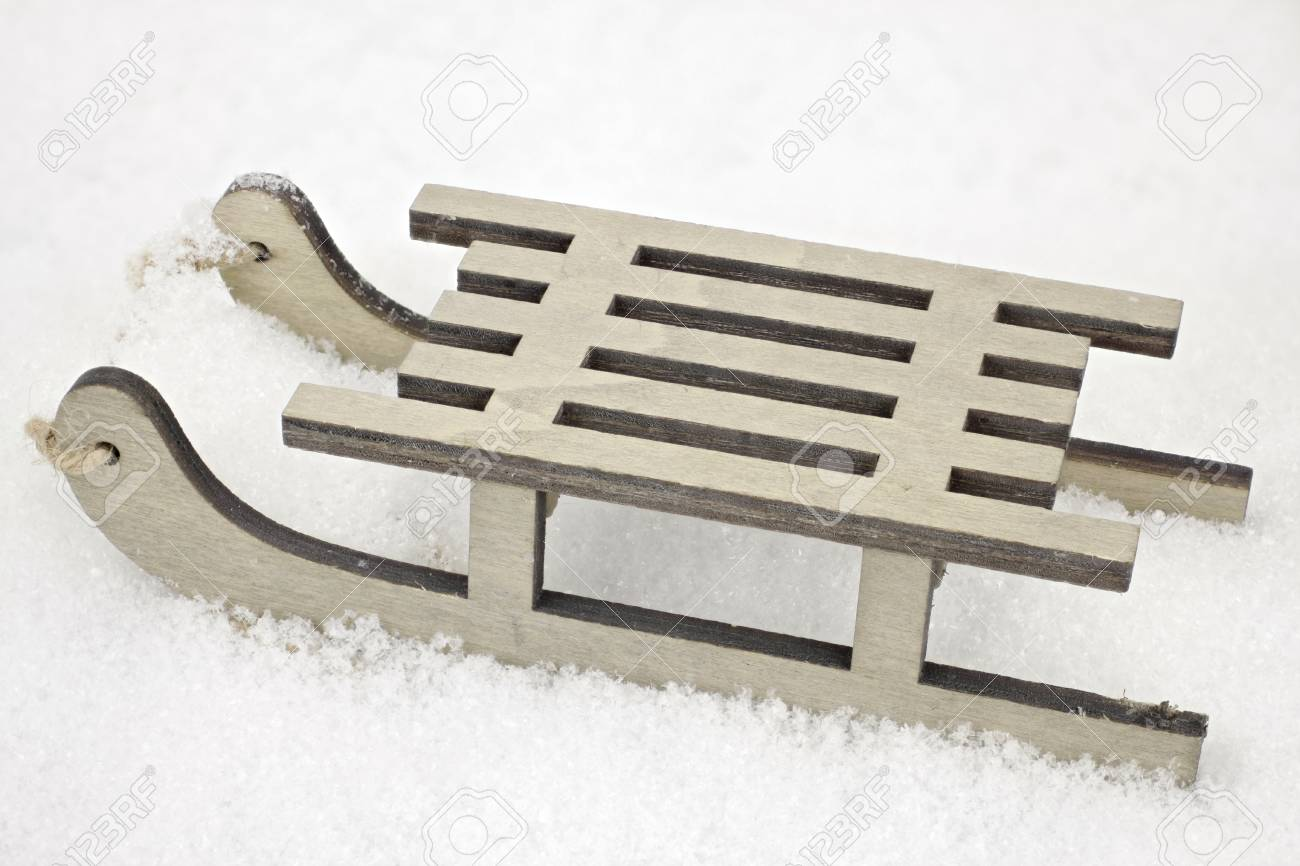 A Small Wooden Sled In Closeup As A Decorative Background