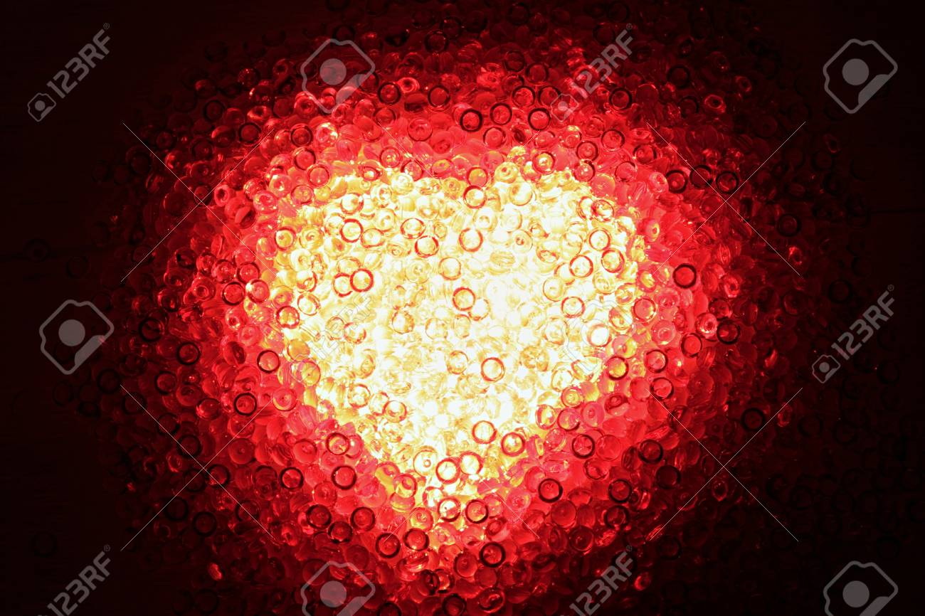 Shining Heart Of Red Decoration Stones Against A Dark Background ...