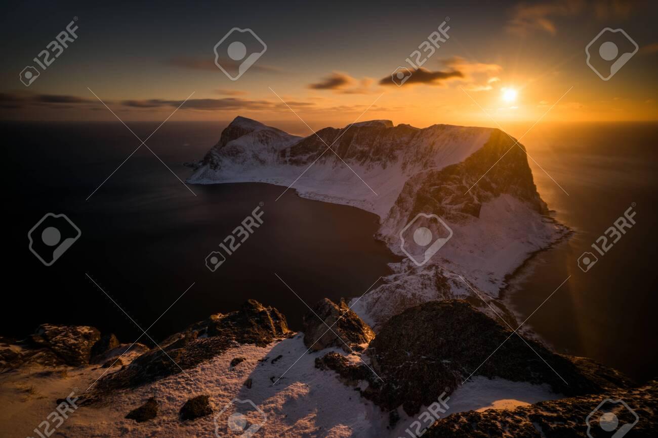 Mountain ridge of Vaeroy island at snowy winter in sunset, Lofoten - 150135865