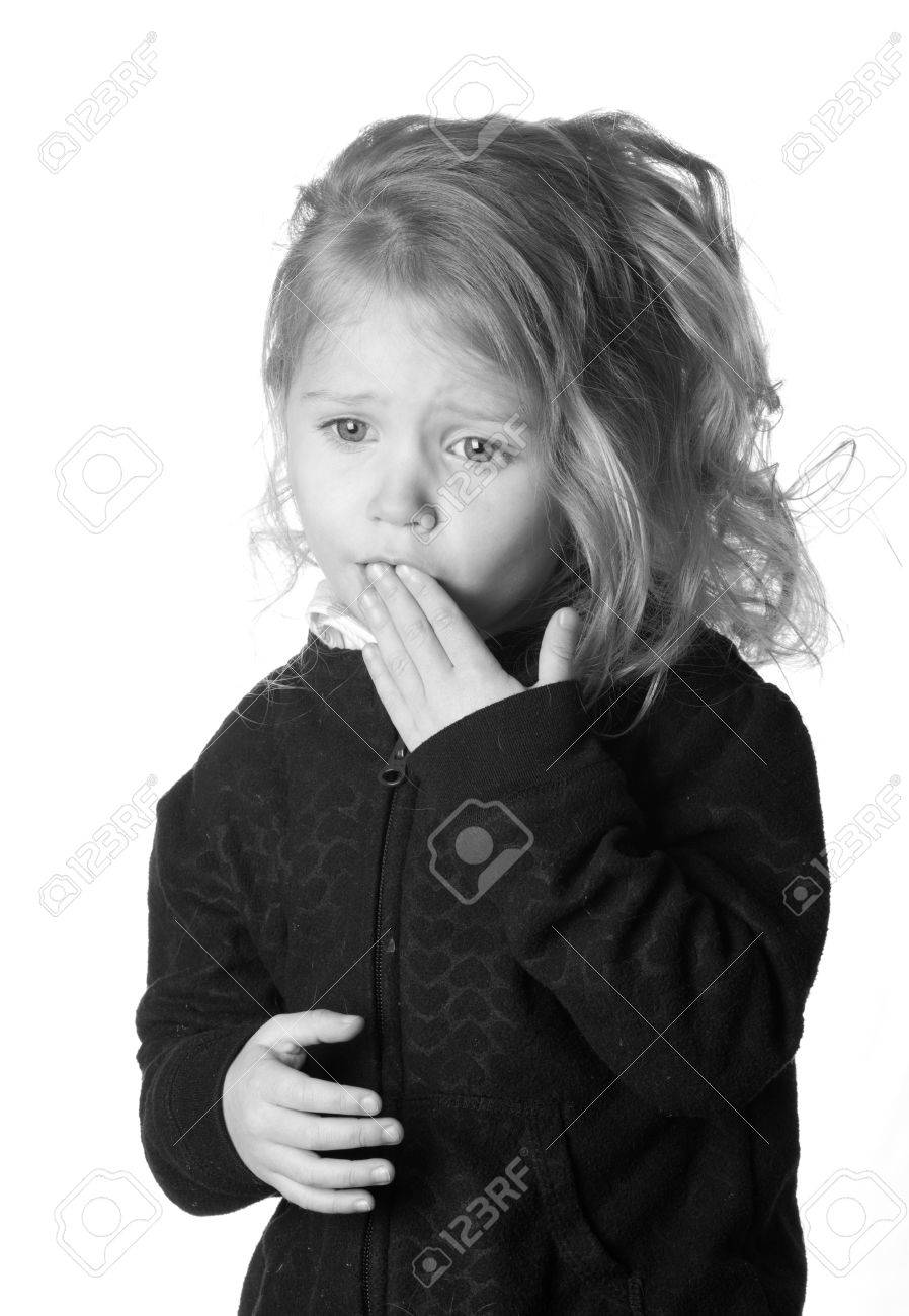 A black and white photograph of  a girl who could be expressing numerous emotions. Stock Photo - 9274803