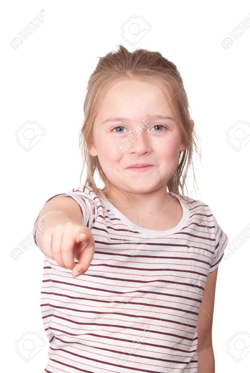 A photograph of a young girl pointing at something with a smirk on her face. Stock Photo - 9501379