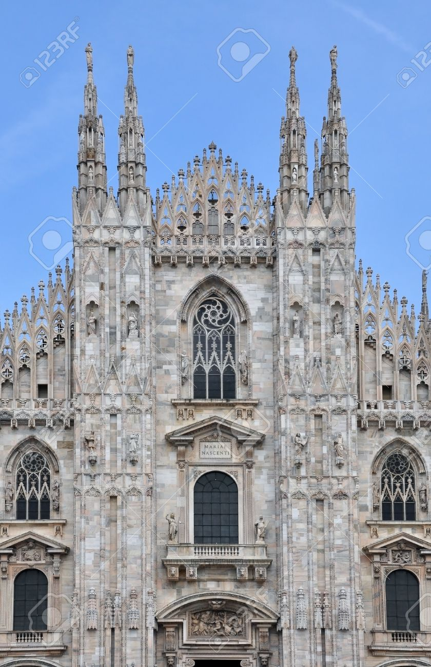 The Front Facade Of Duomo Gothic Cathedral In Milan With Stock