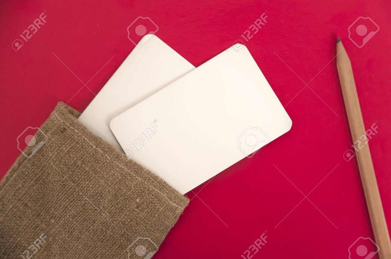 Mock Up Of White Paper Business Cards In Linen Bag On Red Background