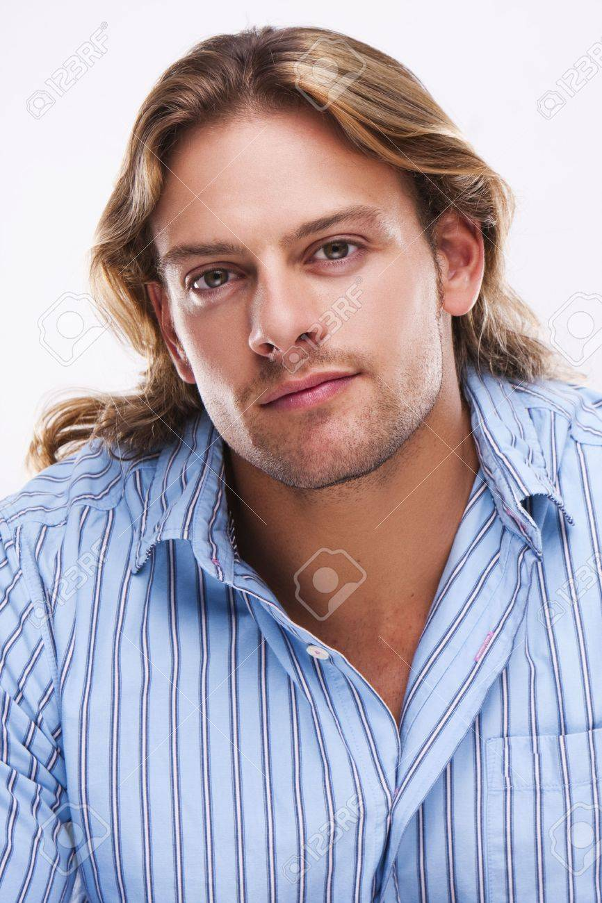 portrait of casual blonde young man wearing blue shirt - 5108826