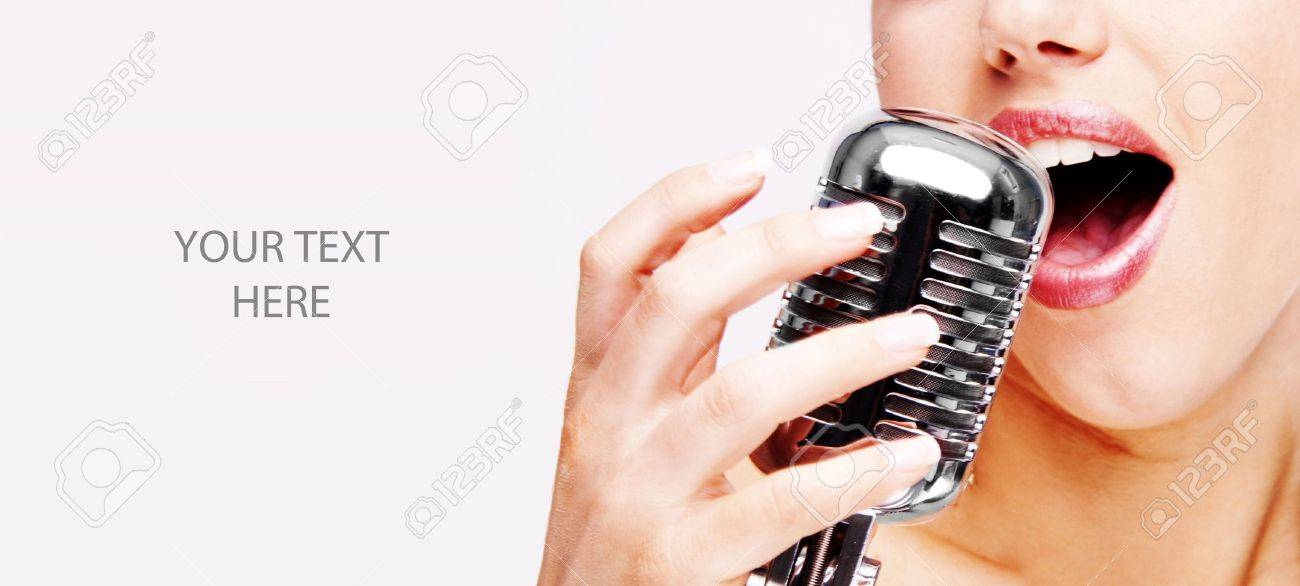 pop female singer with the retro microphone Stock Photo - 5193800