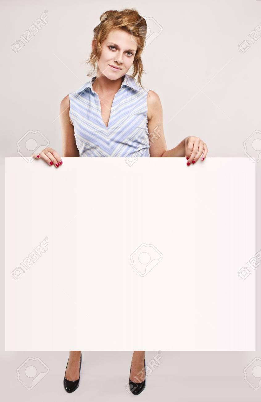 Attractive secretary over white empty board, lots of copyspace Stock Photo - 5246382