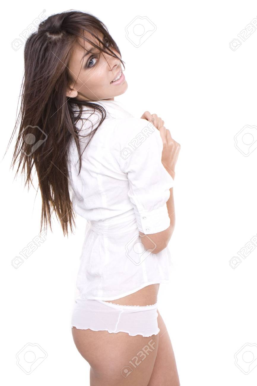 sexy brunette glamour model wearing white shirt and sexy lingerie pants isolated Stock Photo - 5752601