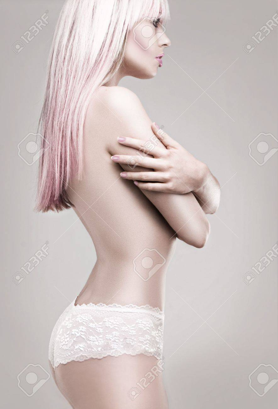 Girl in white panties and pink blonde hair - side view studio shoot Stock Photo - 5810775