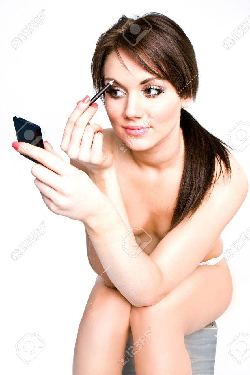 attractive young topless woman applying meke-up Stock Photo - 5835227