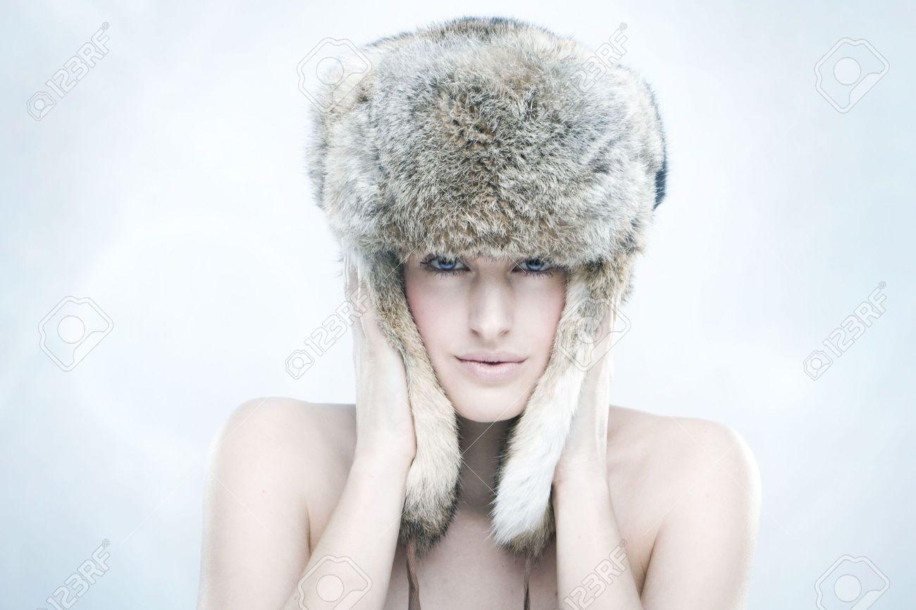 1f5bca5ec portrait of a beautiful girl in a fur russian hat