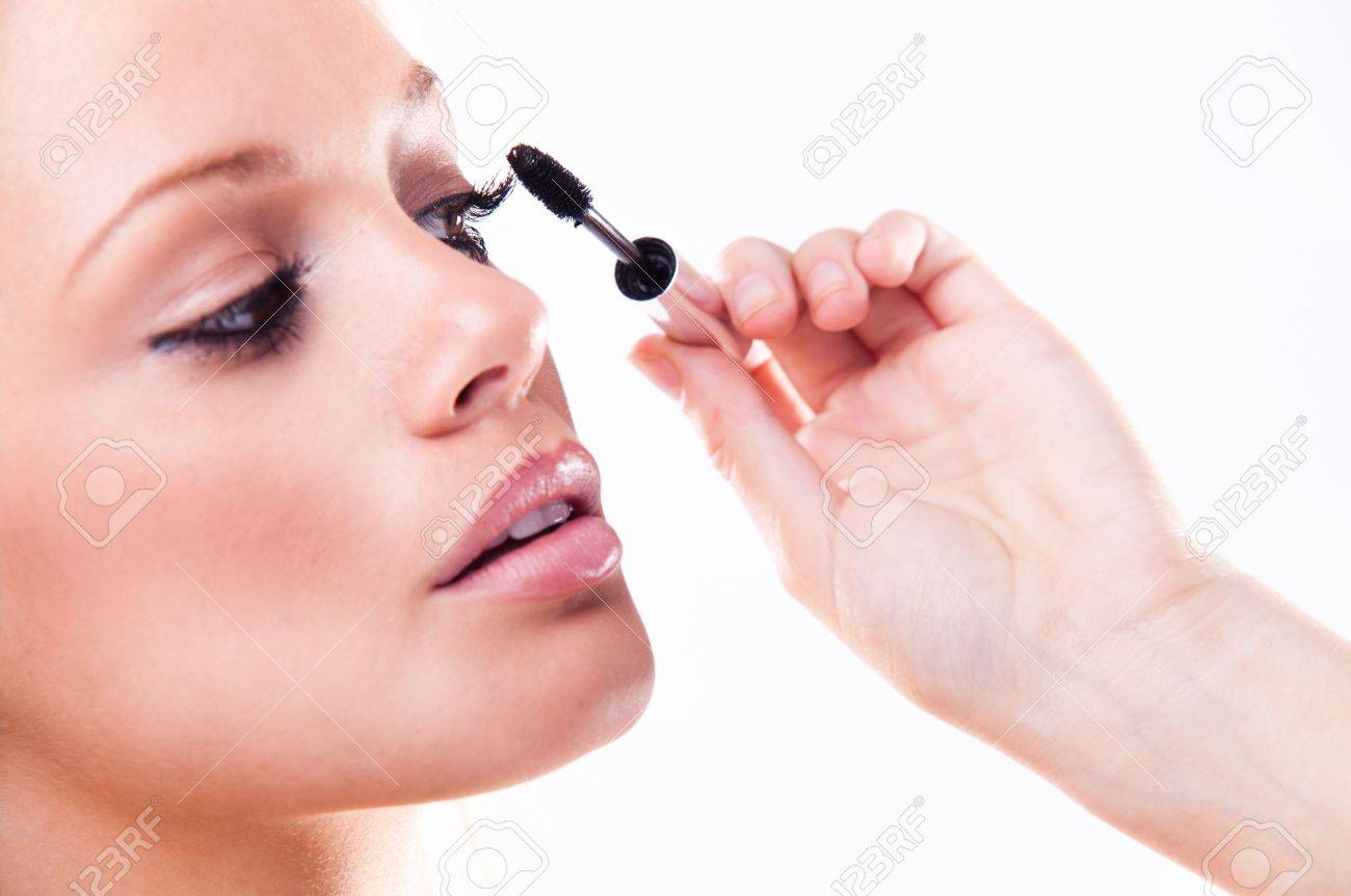 young woman with eyeliner for her eyelashes Stock Photo - 7634024