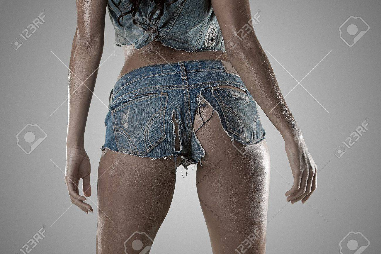 Sexy woman standing from the back wearing wet ripped tiny booty shorts Stock Photo - 8457562