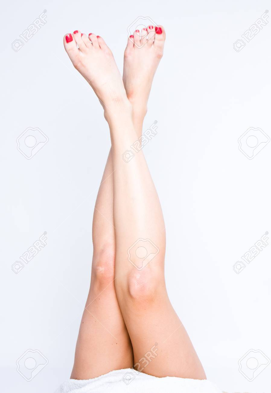 Long pretty woman legs isolated on plain background Stock Photo - 8517839