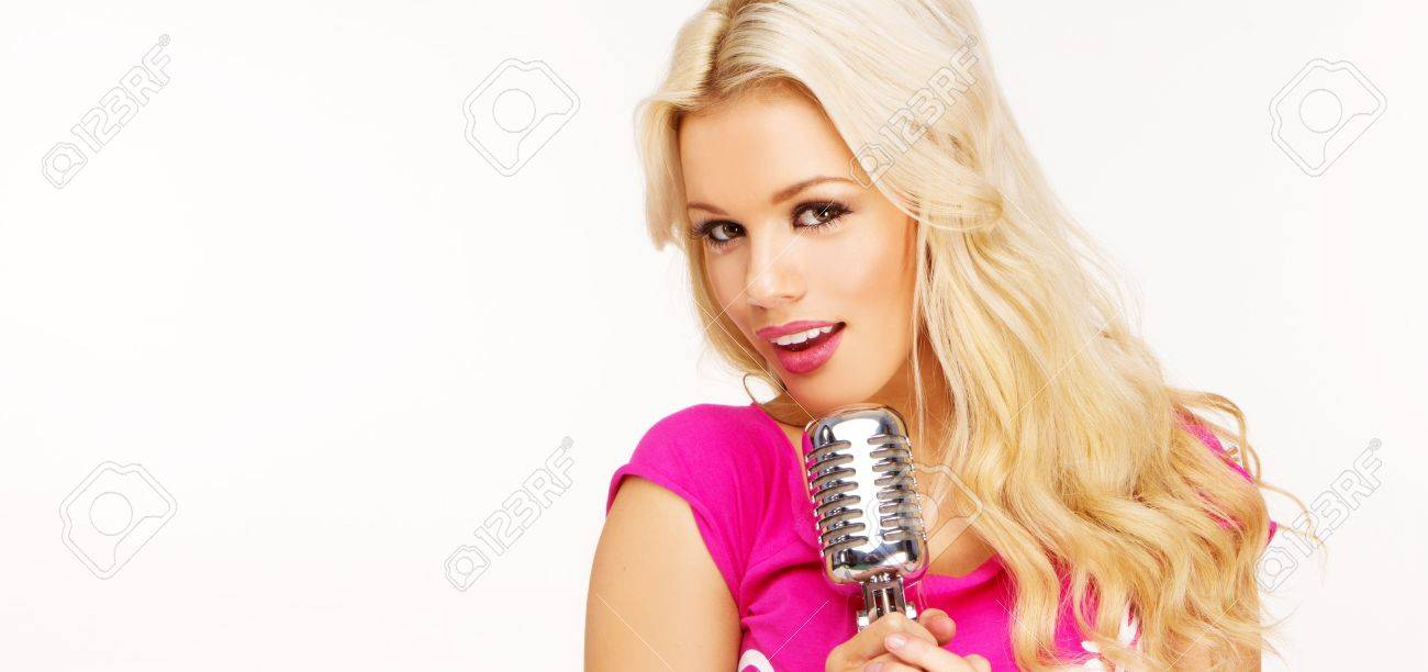 pop female blonde wearing pink singer with the retro microphone banner Stock Photo - 8929188