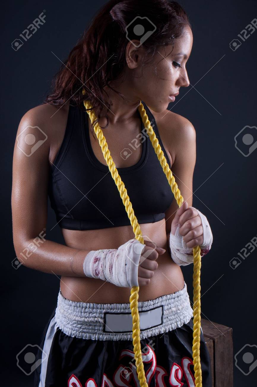 Beautiful fitness body passion for exercising. wet brunette holding a rope - 9427110