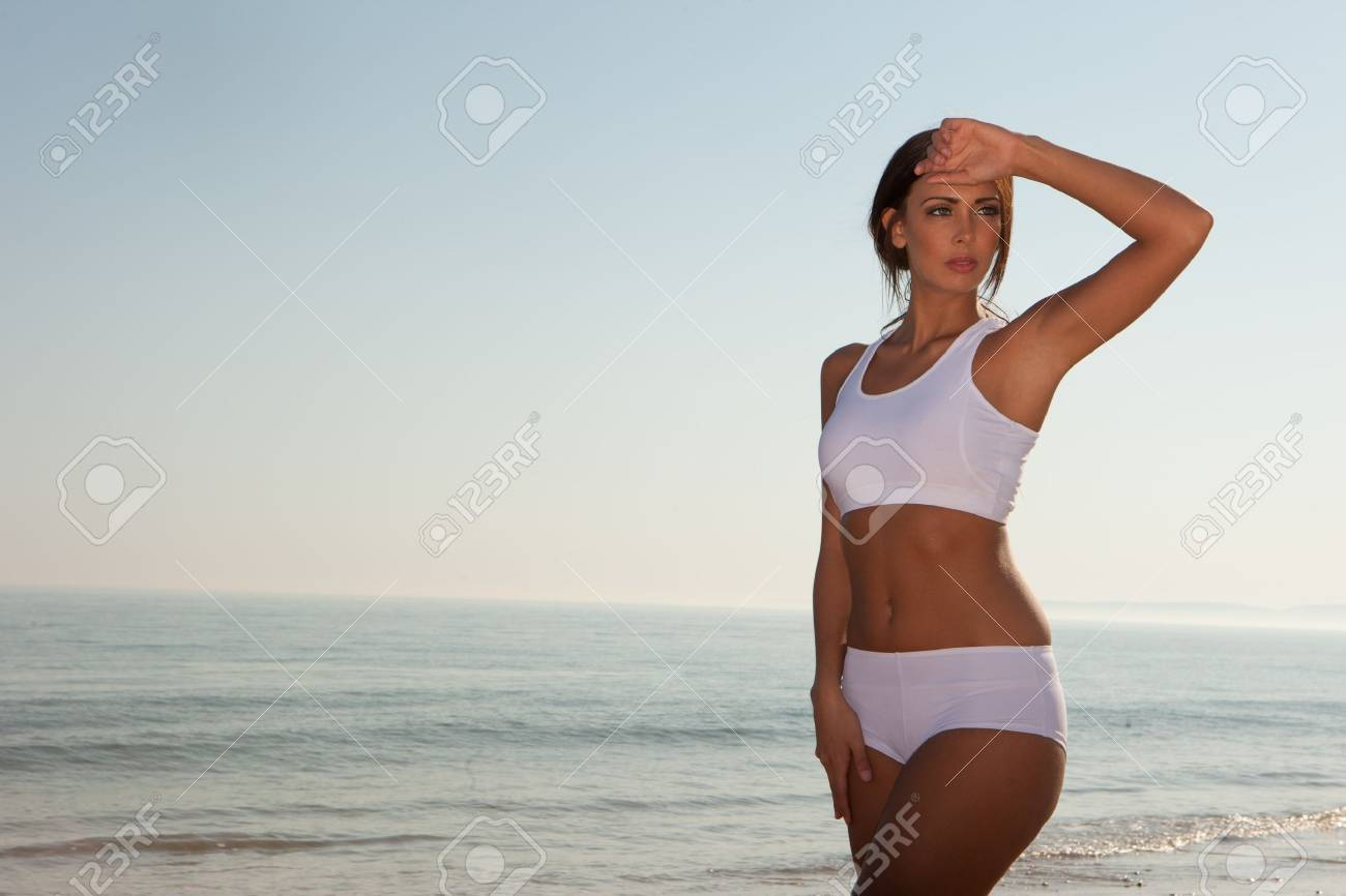 fitness brunette woman exercise on the beach Stock Photo - 9468856