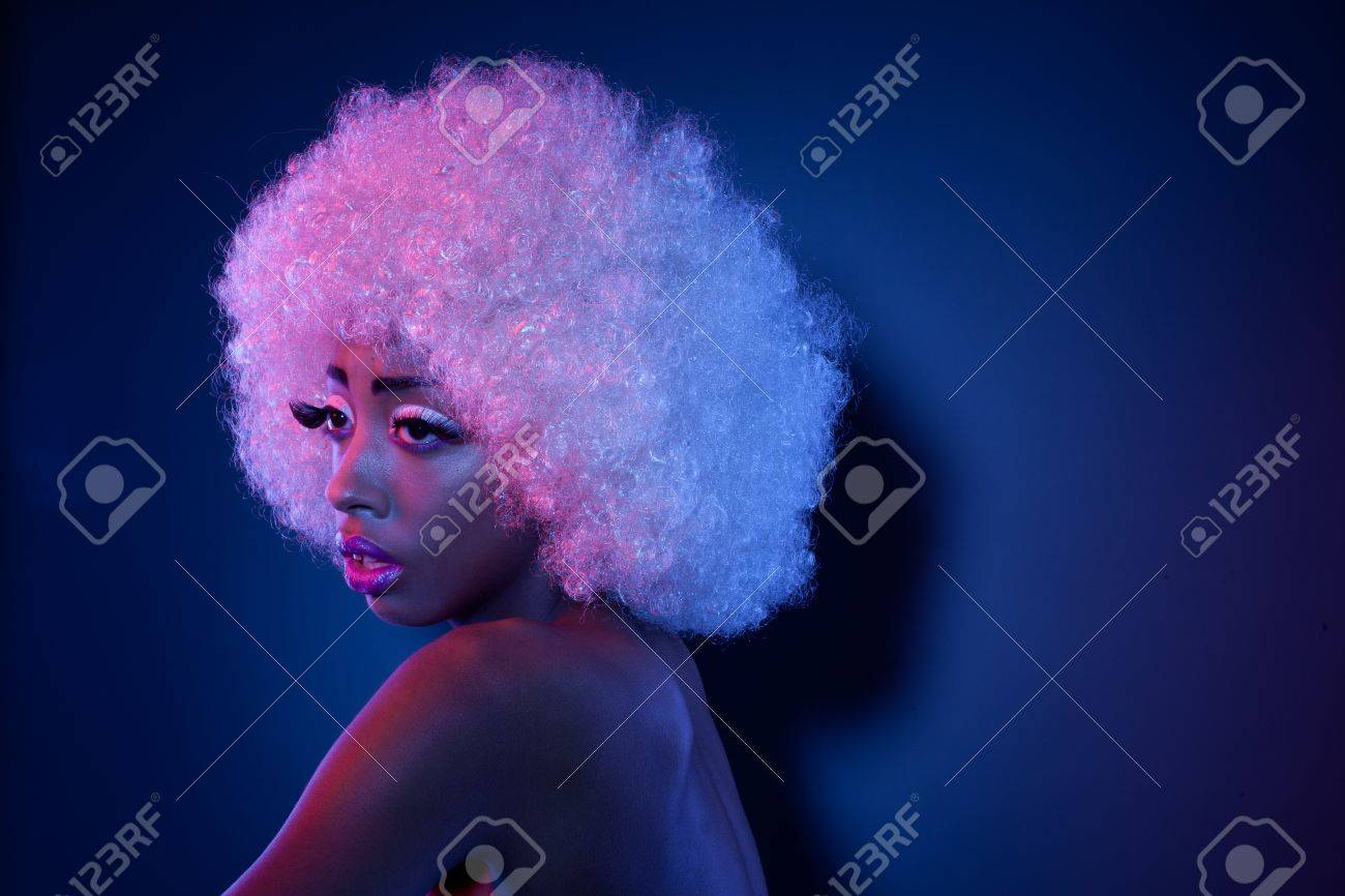 Attractive African model in creative makeup and a large curly white Afro  style wig looking out d4bbe0ec8