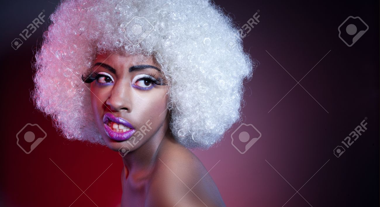 African model wearing a large afro-style white wig with copyspace Stock  Photo - 12588570 a35cb2465