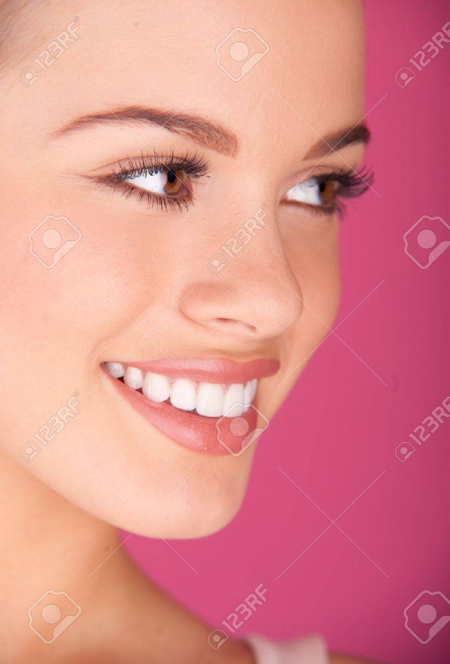 Beautiful young woman perfect teeth smiling - 12587837