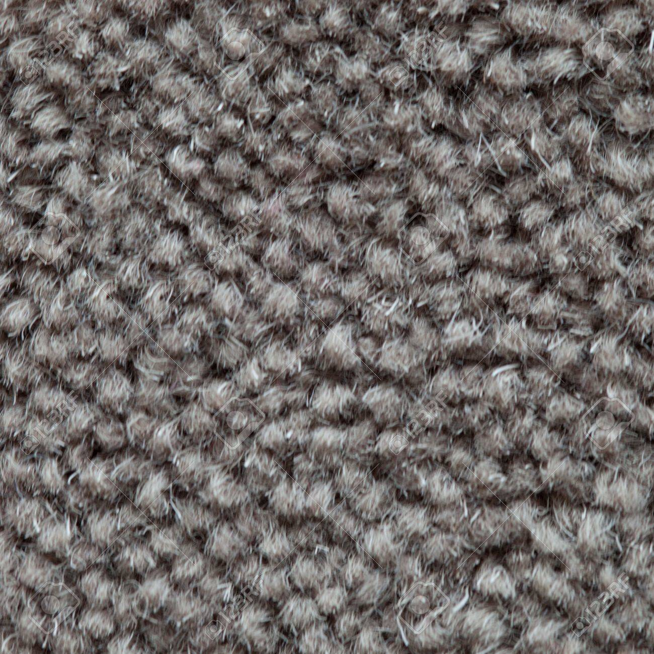 Closeup background of a short pile grey carpet with coarse knotted fibre detail and texture Stock Photo - 21338493