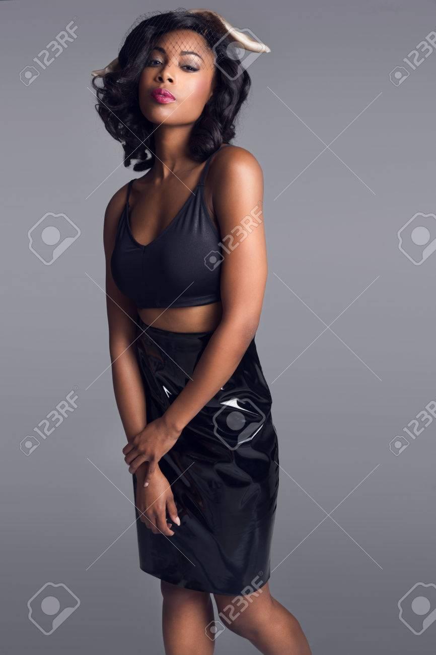 Beautiful African American young woman posing in the studio wearing dress - 28278608