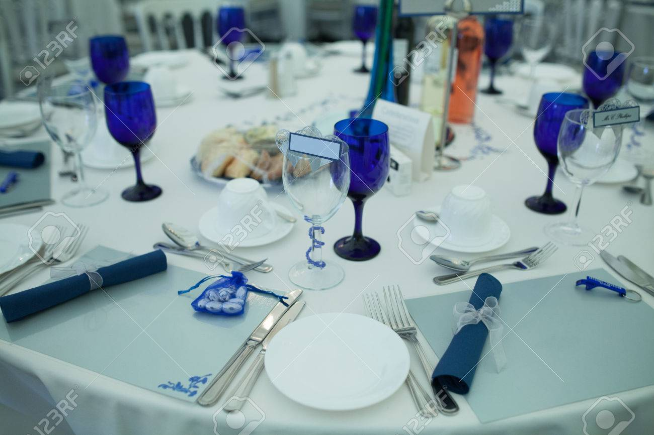 Elegant formal table setting at a wedding reception with white linen and dinnerware with royal blue & Elegant Formal Table Setting At A Wedding Reception With White ...