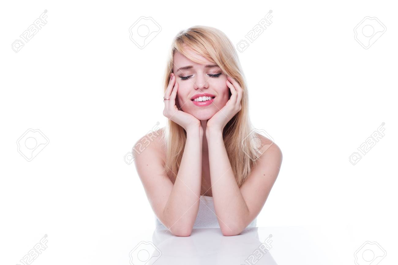 Smiling Young Blond Woman with Eyes Closed and Head Resting in