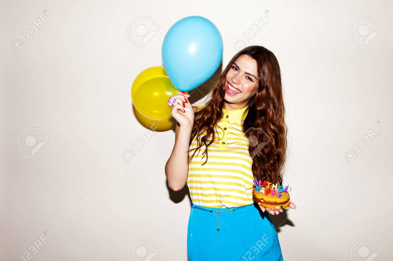 happy brunette woman celebreting her birthday with the cake and ballons - 54885008