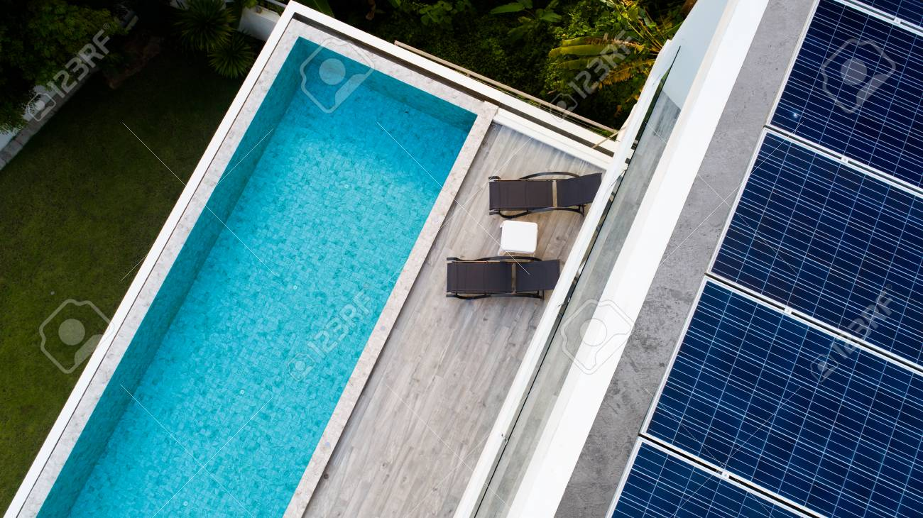 Top View Of Outdoor Swimming Pool And Solar Panels On The Roof ...