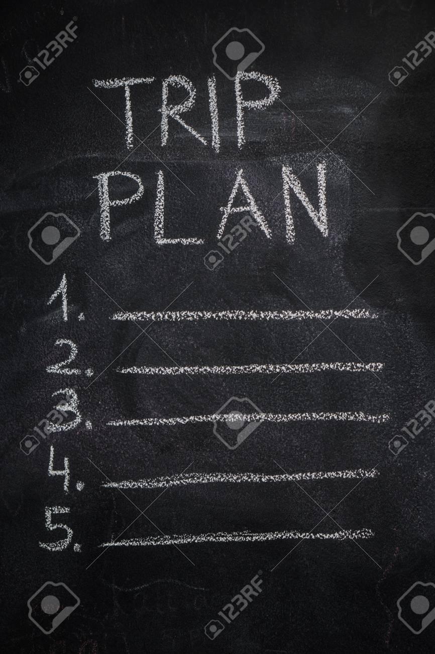 trip plan list written with white chalk on blackboard to do stock