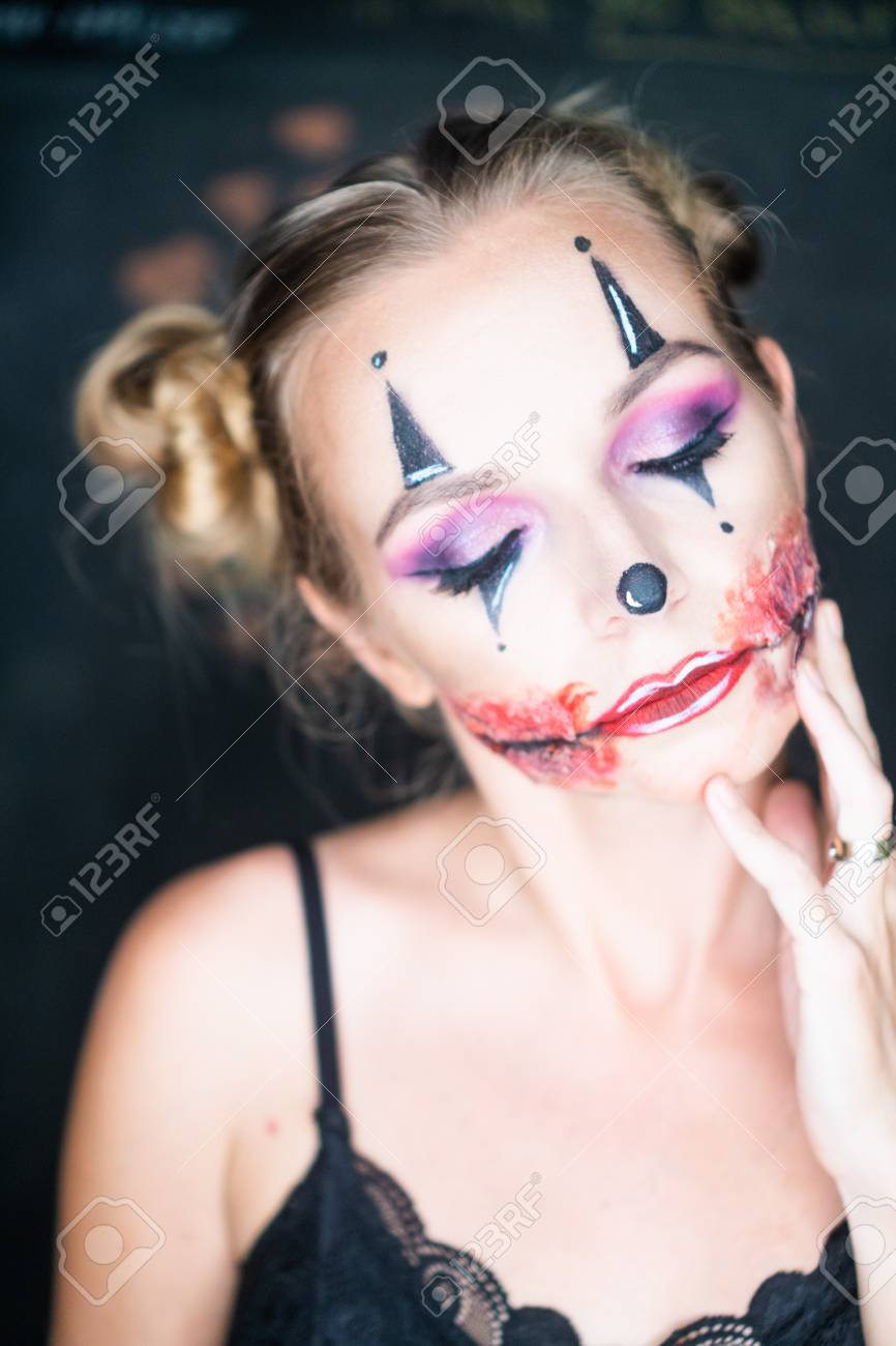 Closeup Face Of Woman With Creepy Halloween Clown Makeup Looking Stock Photo Picture And Royalty Free Image Image 110174845