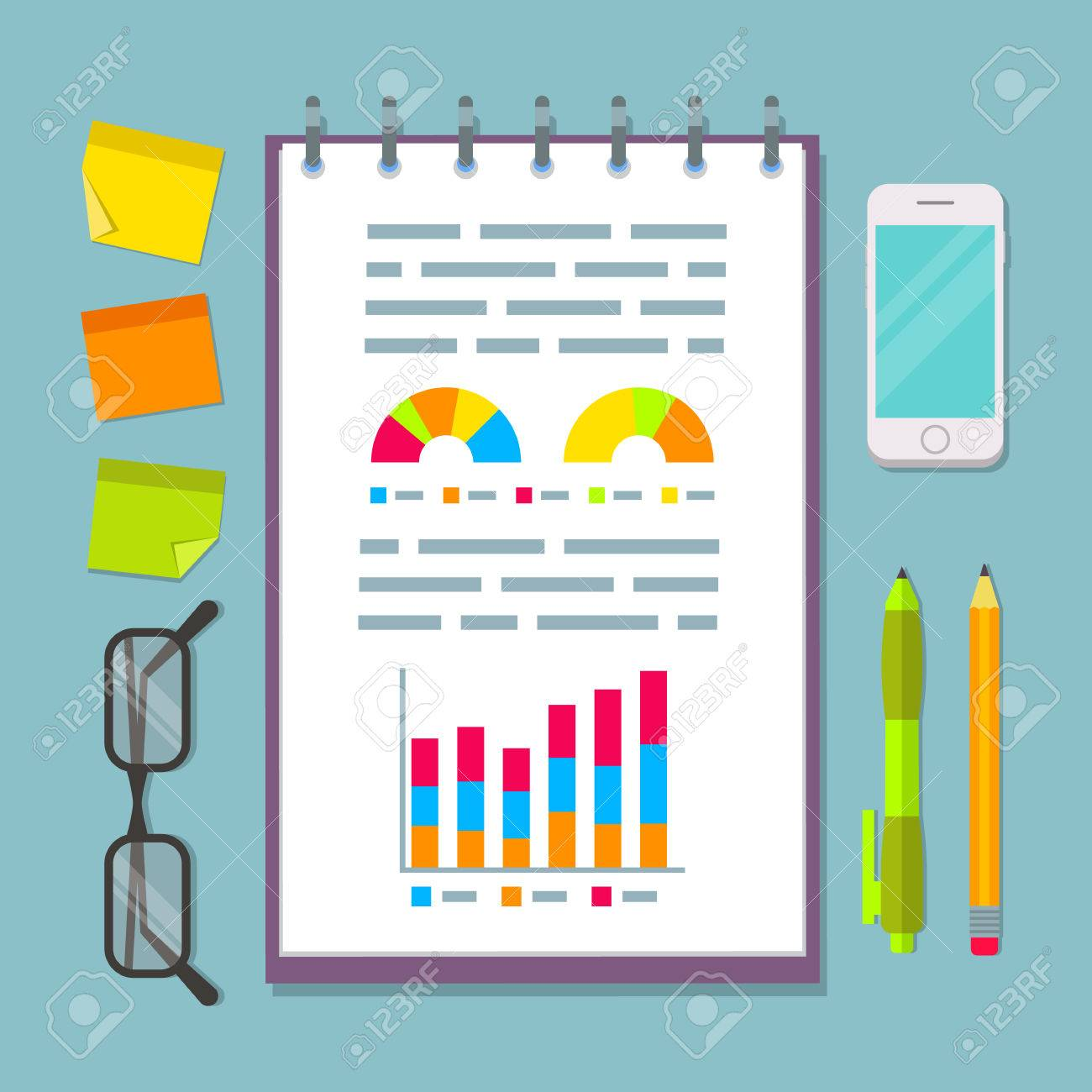 open vertical spiral notebook with business plan charts graphs