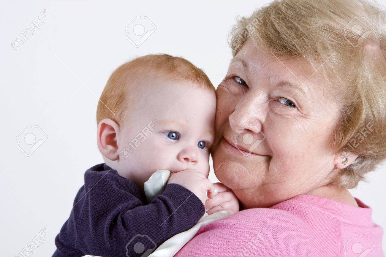 Proud grandmother holding red headed grandson Stock Photo - 3124465