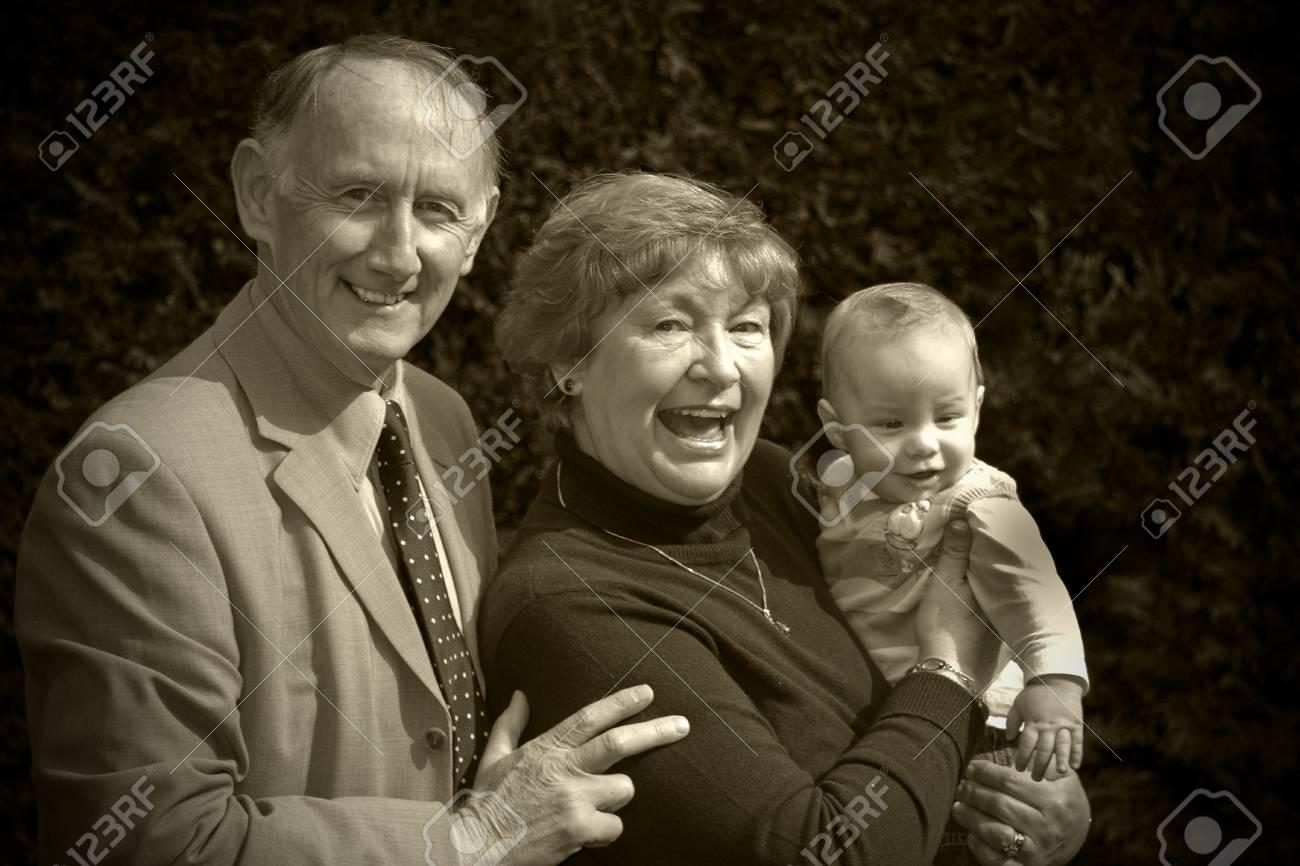 Grandparents with their grandson portrait in garden Stock Photo - 3124437