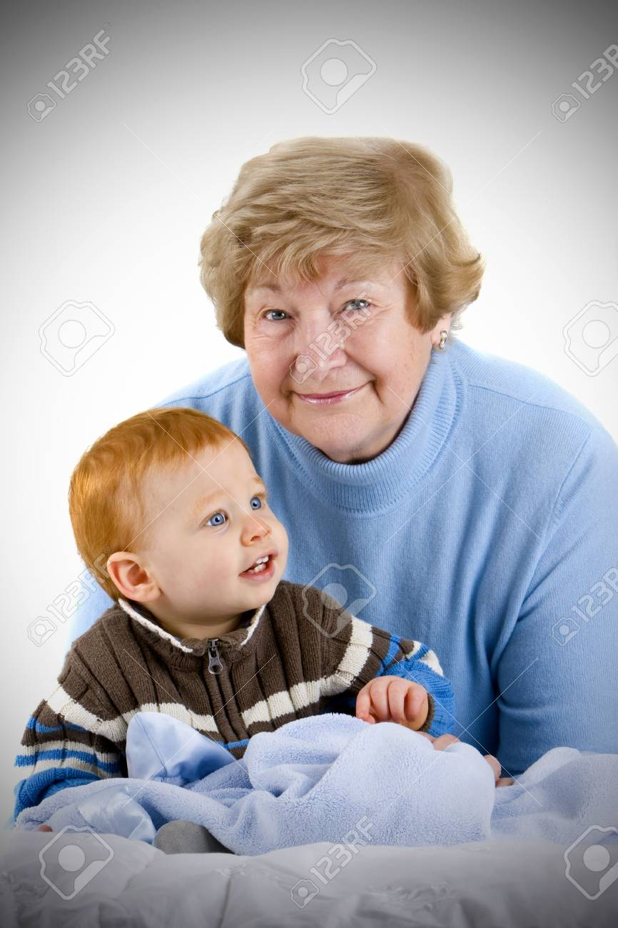 Happy grandmother with redheaded grandson sitting with blanket Stock Photo - 4020198