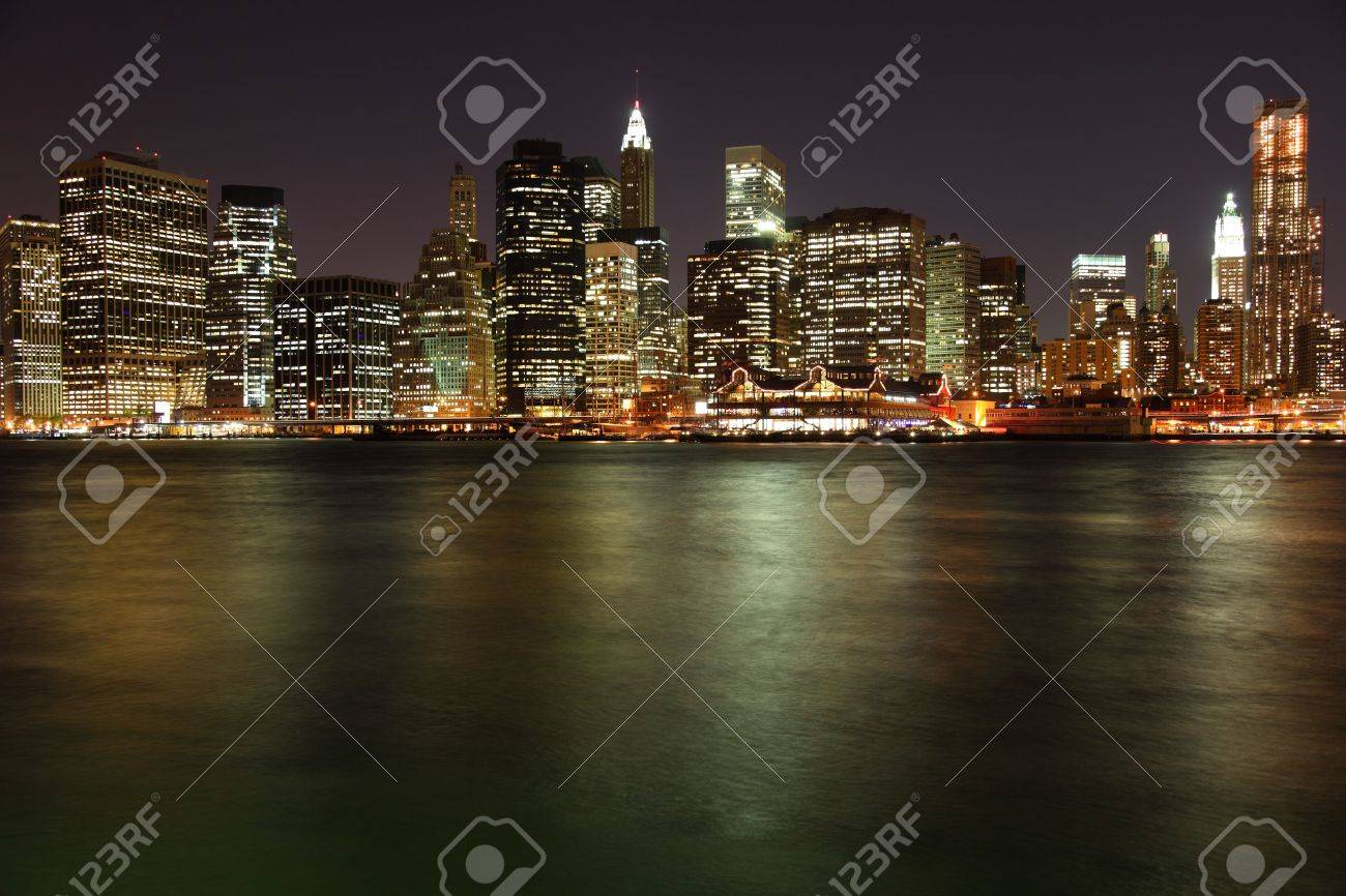 Lower Manhattan in New York City at night with reflection in water Stock Photo - 6948149