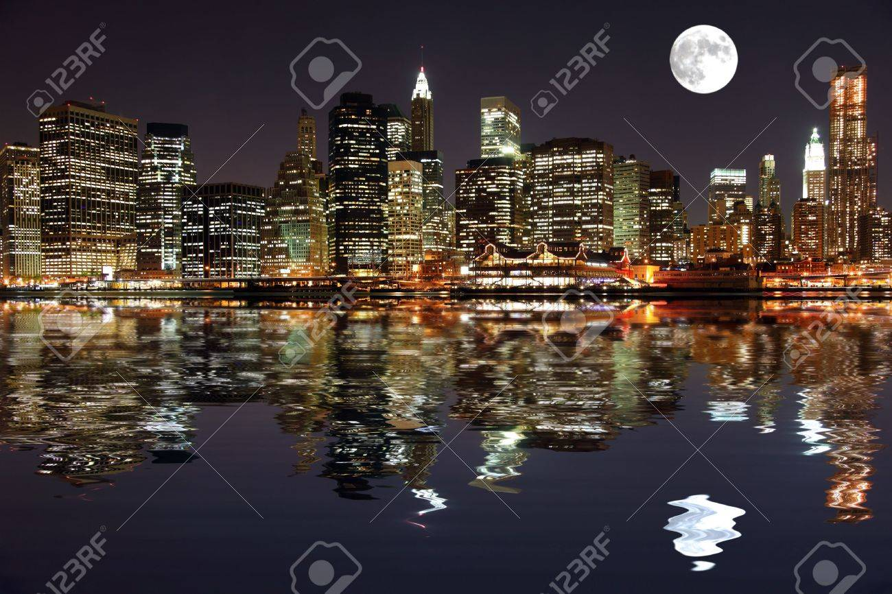 Lower Manhattan in New York City at night with reflection in water Stock Photo - 7634281