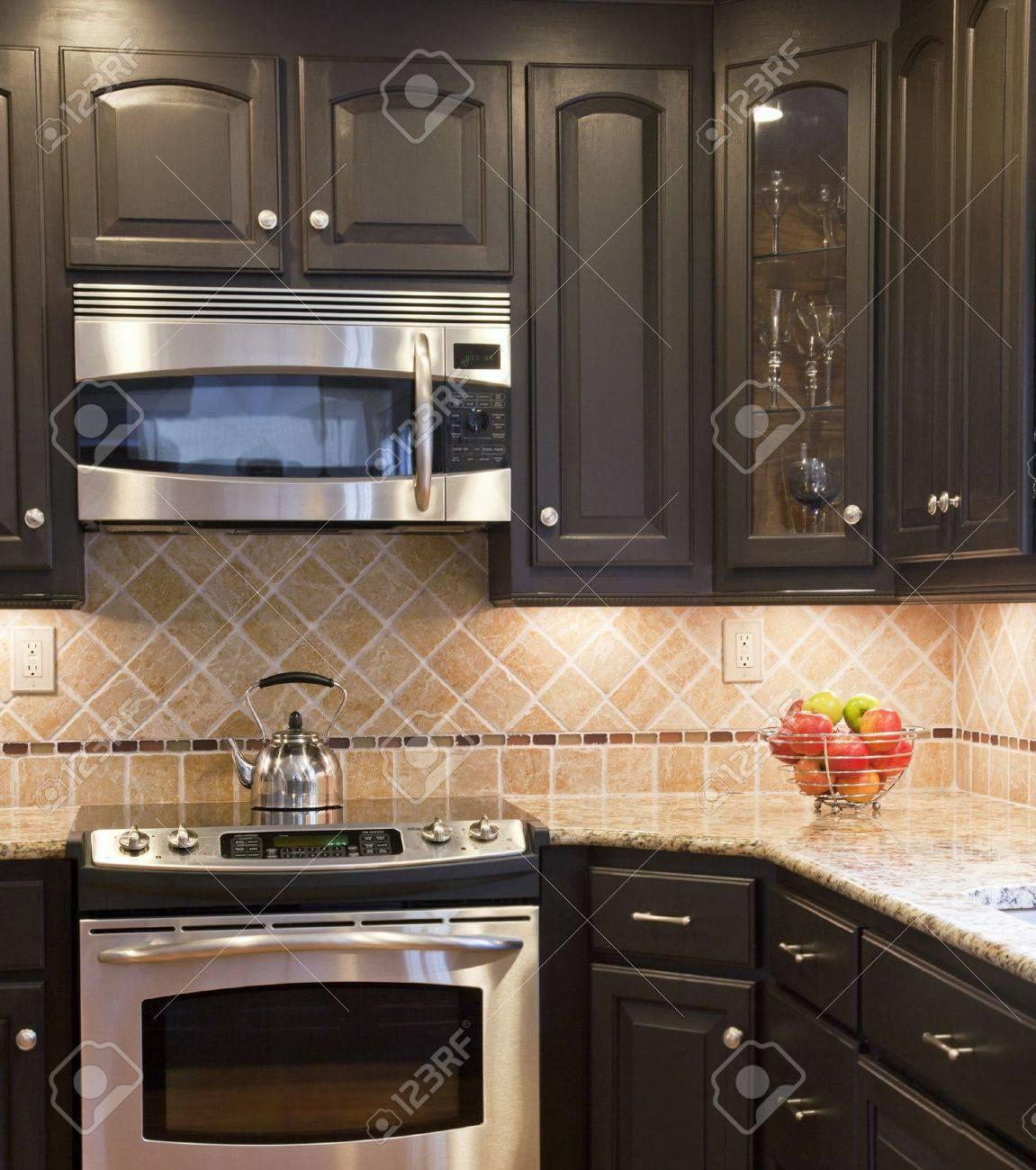 Modern kitchen with dark brown woodedn cbinets Stock Photo - 11560557