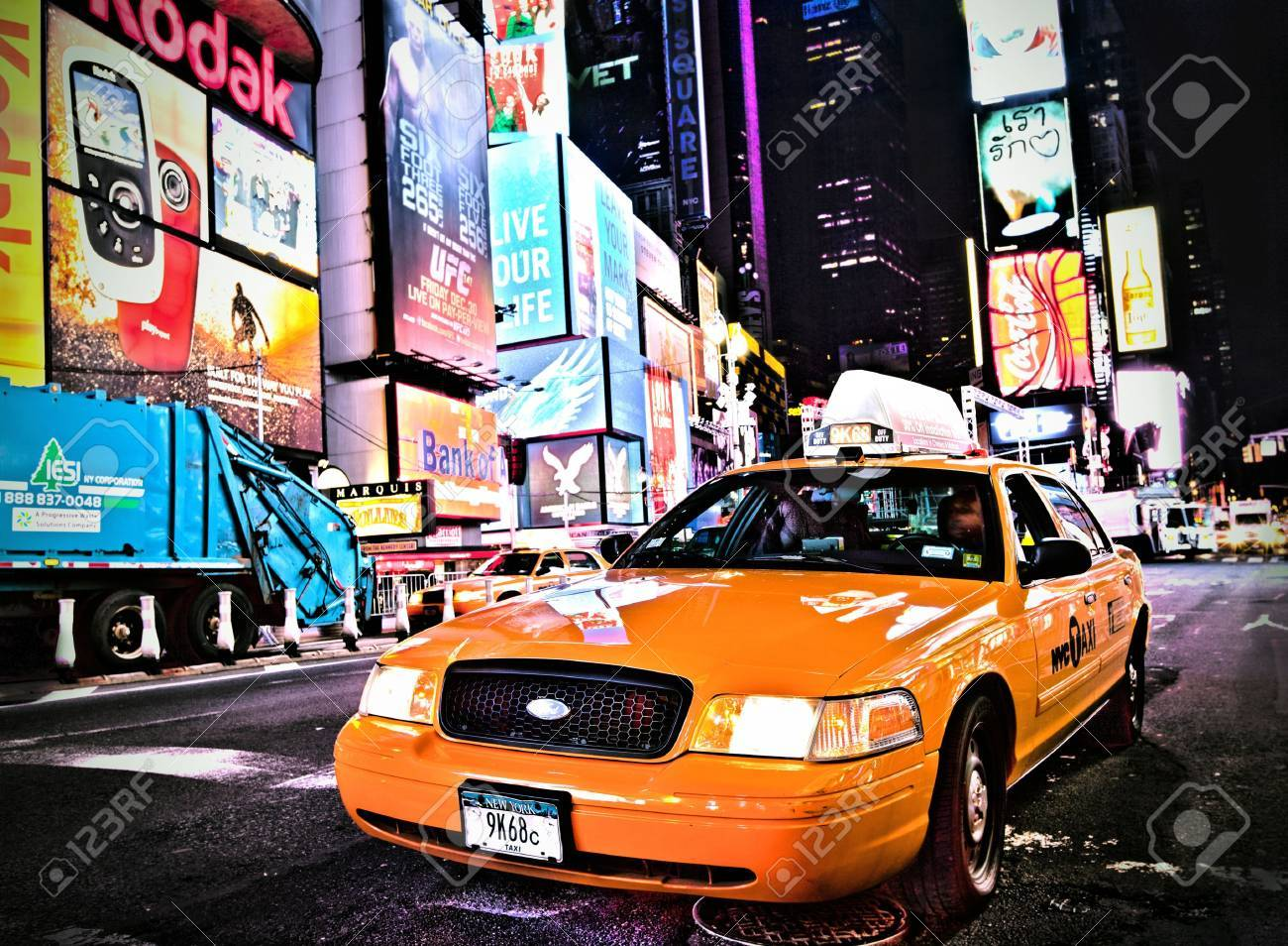 NEW YORK CITY - DEC 28: Times Square ,is a busy tourist intersection of neon art and commerce and is an iconic street of New York City and America, December 28th, 2011 in Manhattan, New York City.  Stock Photo - 12160354