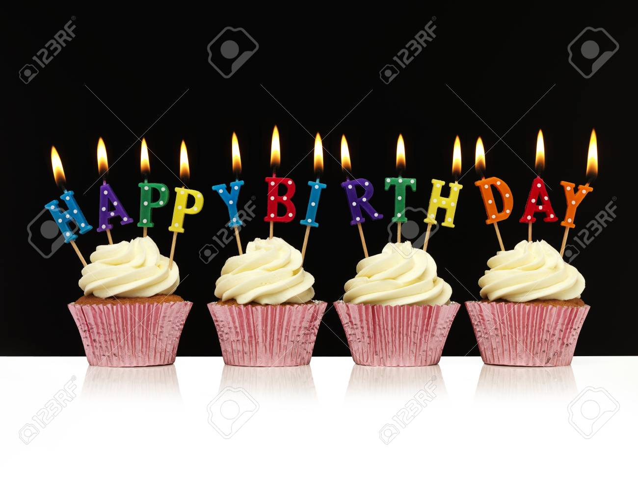 Cupcakes With Happy Birthday Candles Stock Photo