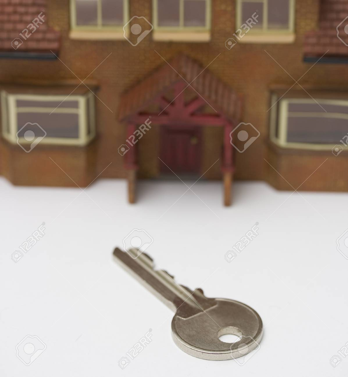 Front door key and miniature house Stock Photo - 1406363