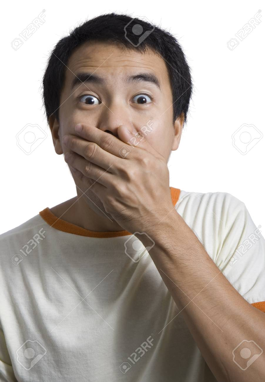 a man covering his mouth and looking very shocked Stock Photo - 1476891