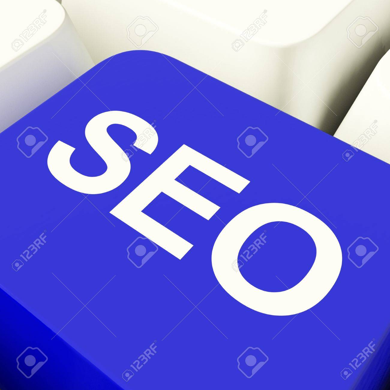 SEO Computer Key In Blue Showing Internet Marketing And Optimisation Stock Photo - 11947574