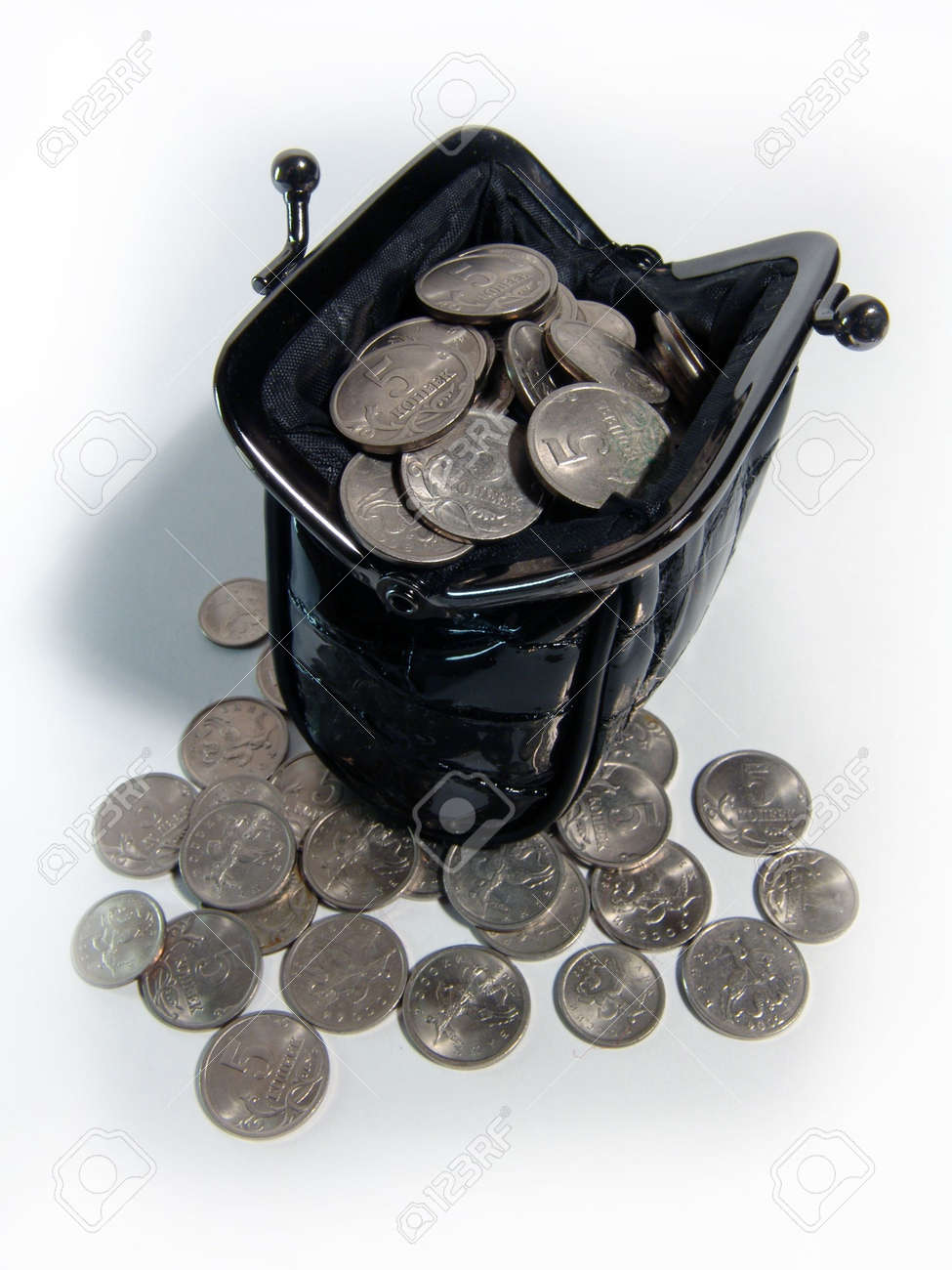 A photo of black women coin purse full of coins Stock Photo - 311115