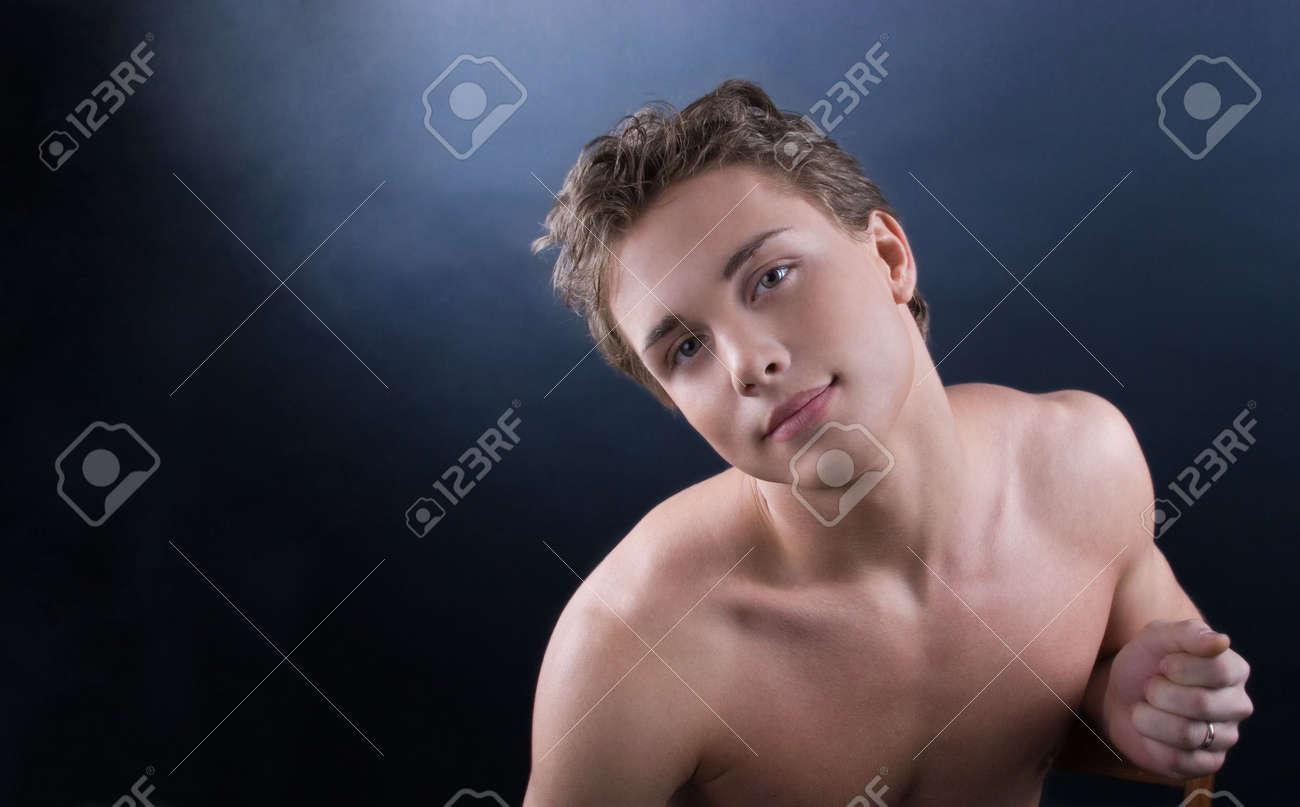 Young man posing against dark bakground Stock Photo - 943241