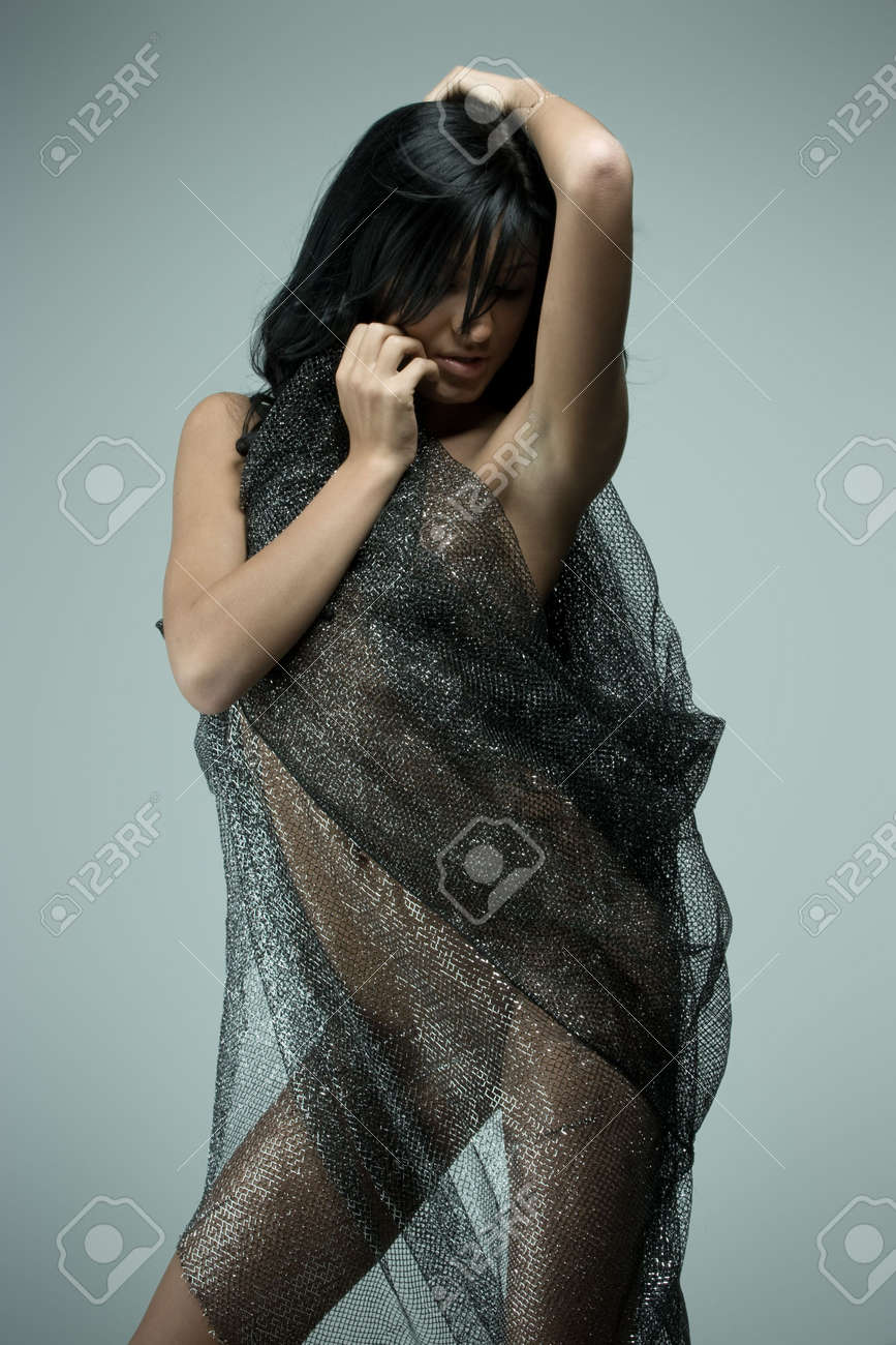 Beautiful naked woman with transparent material in front of her Stock Photo - 4919715