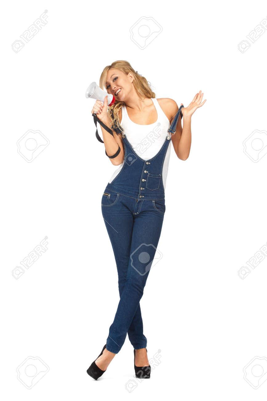 Young blonde woman  shouting through  megaphone Stock Photo - 11157821