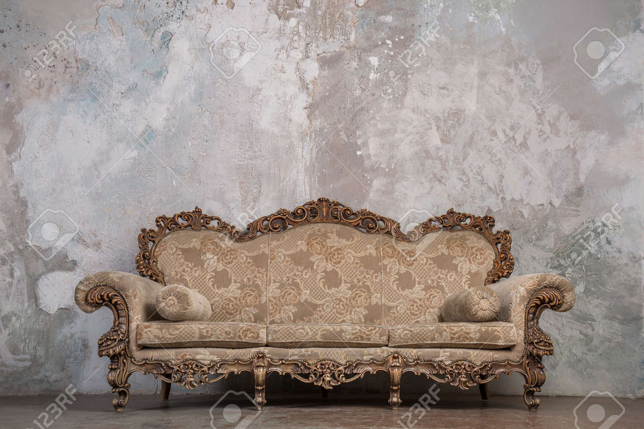 Antique Sofa Against Old Stucco Background Stock Photo Picture And